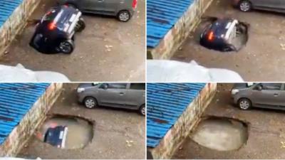 पार्किङ गरिराखेको कार जमिन भासिएर खाल्डोमा